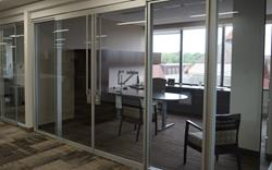 Installation of Teknion Optos Floor to ceiling demountable walls for private offices